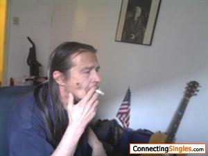Guitar playing long hair that smokes