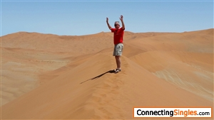 Climbing a dune in Namibia