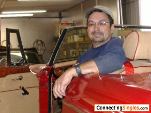 here I am in an MG I like to work with my hands restored several of these old cars