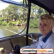 At the helm on the Intercoastal waterway F L on Daughters Son In Laws Yacht motoring to dry Tortugas enjoying the waters wea