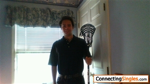 This is me with my lacrosse stick, which I used this past year during games to block other players.