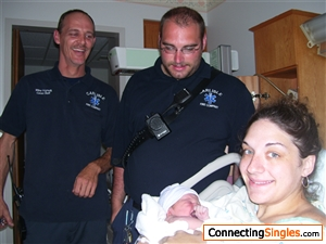 Im the guy in the middle with no name tag on his shirt. That's my niece when she was born.