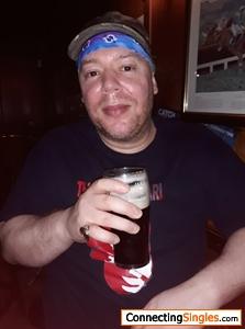 Enjoying a pint of Guinness at Friday Kareoke night at my local pub
