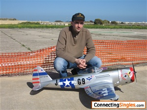 my radio remote control aircraft a model of the p 47 thunderbolt used in world war2 powered by a 4 stroke o s branded engine