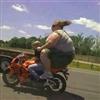 Huge women on back of bike