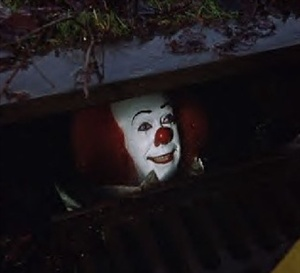 What is the name of the film adapted from Stephen king's story about 'Pennywise the dancing Clown' who likes to eat kiddies and the occasional nuisance adult..