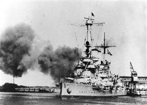 On September 1st 1939 World War II officially began with the German invasion of Poland. The first shots of the war were fired at Westerplatte, Gdansk. Firing at a Polish army barracks and munitions depot, these first shots of the war precisely at 4.47 a.m. were fired from a 'visiting' German battleship anchored in port. Name this German battleship.