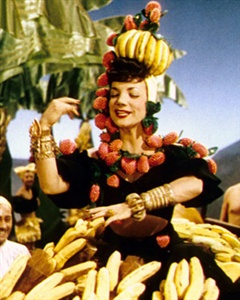 Who is the woman in the photo with the fetching fruit hat?