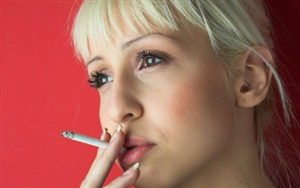 WHAT AGE DID YOU FIRST SMOKE A FILTERED CIGARETTE?