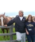 My daughter, Sarah and I with Rudy and Chiquatta, the horses. Hmm, according to her t-shirt, it's not her day to care, lol.