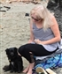 July 2017. At the beach why'd I even bother curling my hair?  This dog fell in love with me, he was so sweet.