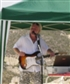 charity gig. Absolutely roasting hot that day. Tell you what´s funny, I had camo shorts on that day. Makes my legs disappear in the photo. Well, It made me laugh, anyway :)
