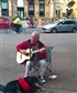 Busking, London. The dog just followed me.