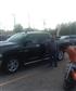 At the dealership looking at trucks.
