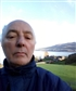 """This selfie was taken in the north of Scotland; in my background are Loch Ness (""""Loch"""" is Scots for """"lake"""") and Urquhart Castle."""